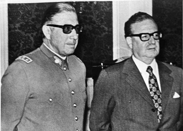 File photo showing then-Chilean President Allende and General Pinochet at the presidential palace La Moneda in Santiago. Then-Chilean President Salvador Allende (R) and General Augusto Pinochet are seen at the presidential palace La Moneda in Santiago in this undated file photo. September 11, 2005 marks the 32th anniversary of the coup d'etat in Chile that ushered in a 17-year dictatorship under Pinochet. More than 3,000 people died or disappeared because of political violence during Pinochet's 1973-1990 military rule. REUTERS/Stringer/File - RTRNIEW