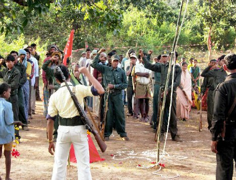 communist-party-of-india-maoist-cadre-celebrate-the-founding-day-of-their-guerrilla-wing-the-people_s-liberation-guerilla-army-near-chainpur-in-palamu-district-jharkhand-on-decem